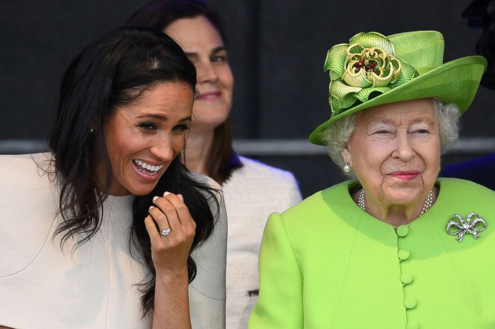 Sussex and Queen Elizabeth II laugh during a ceremony to open the new Mersey Gateway Bridge
