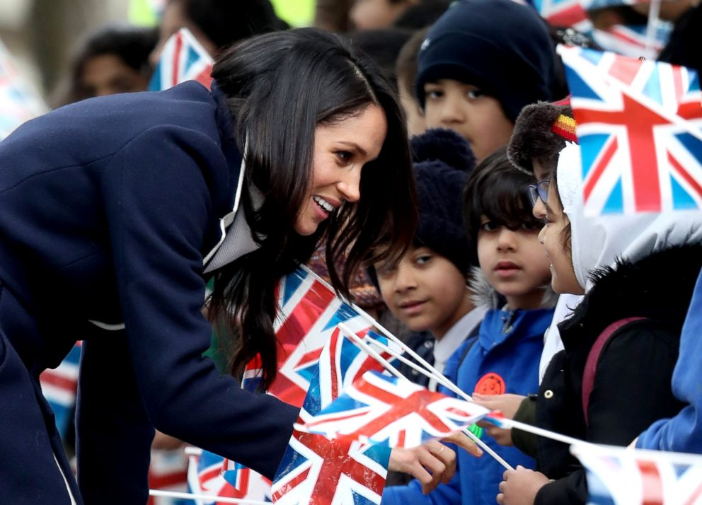 PHOTO: Meghan Markle talks to children as she arrives to Birmingham, March 8, 2018, in Birmingham, England.
