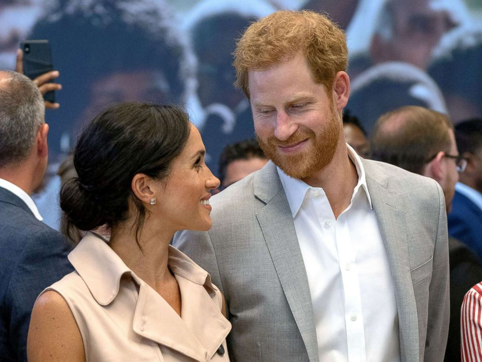 PHOTO: Prince Harry, Duke of Sussex and Meghan, Duchess of Sussex visit the Nelson Mandela Centenary Exhibition at Southbank Centres Queen Elizabeth Hall on July 17, 2018 in London.