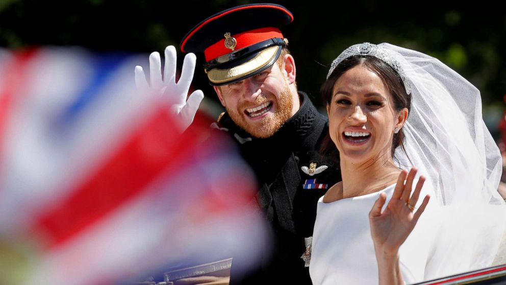 Britain'?s Prince Harry and his wife Meghan wave as they ride a horse-drawn carriage after their wedding ceremony at St George'?s Chapel in Windsor Castle in Windsor, England, May 19, 2018.