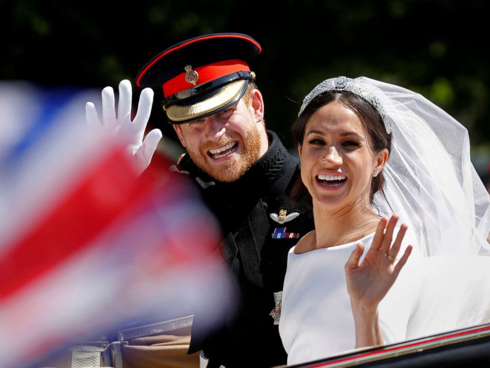 PHOTO: Britain?s Prince Harry and his wife Meghan wave as they ride a horse-drawn carriage after their wedding ceremony at St George?s Chapel in Windsor Castle in Windsor, England, May 19, 2018.