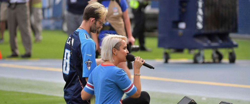 PHOTO: Recording artist Meghan Linsey kneels after singing the national anthem before the game between the Tennessee Titans and the Seattle Seahawks at Nissan Stadium, Sept. 24, 2017.