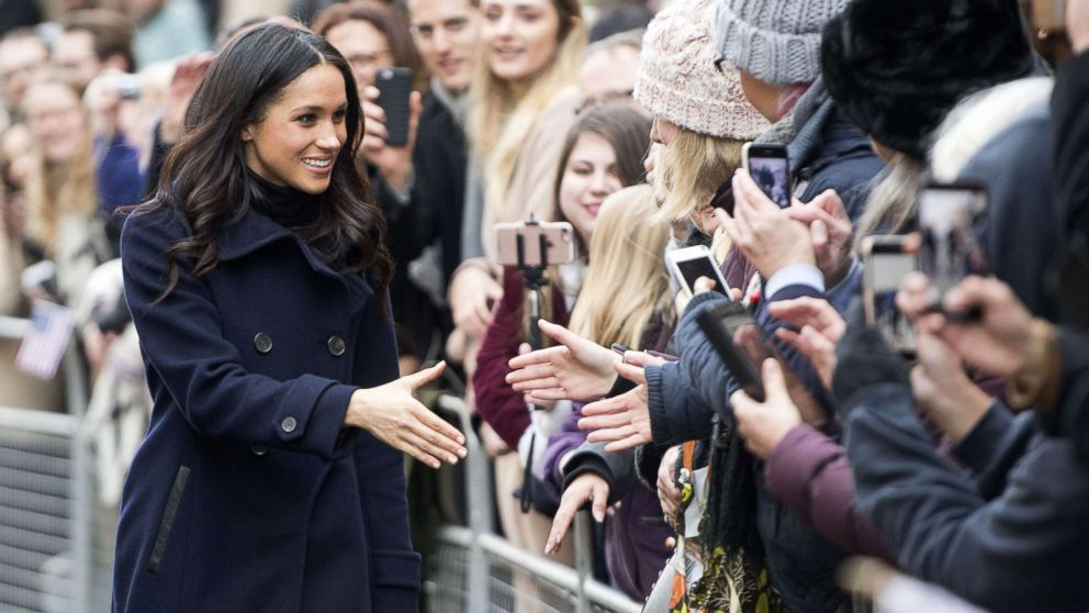 Meghan Markle greets the crowd as she and Prince Harry visit the Terrence Higgins Trust World AIDS Day Charity Fair in Nottingham, England, Dec. 1, 2017.