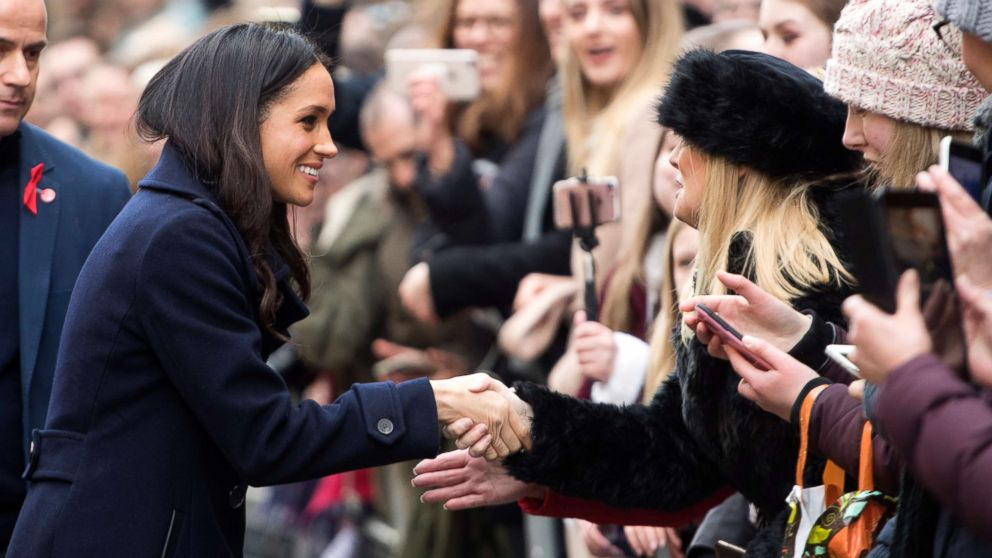 Meghan Markle interacts with the crowd as she and Prince Harry visit Nottingham Comtempory in Nottingham, England, Dec. 1, 2017.
