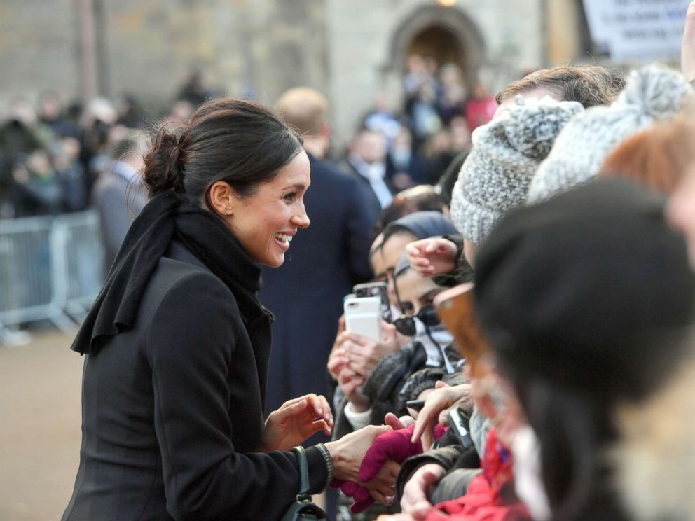 PHOTO: Prince Harry and Meghan Markle greet the crowds during their first visit to Wales since the announcement of their engagement, Jan. 18, 2017, in Cardiff, Wales.