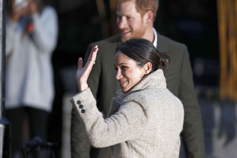 PHOTO: Britains Prince Harrys fiance, U.S. actress Meghan Markle, waves to well-wishers as they leave after a visit to Reprezent 107.3FM community radio station in Brixton, south west London, Jan. 9, 2018.