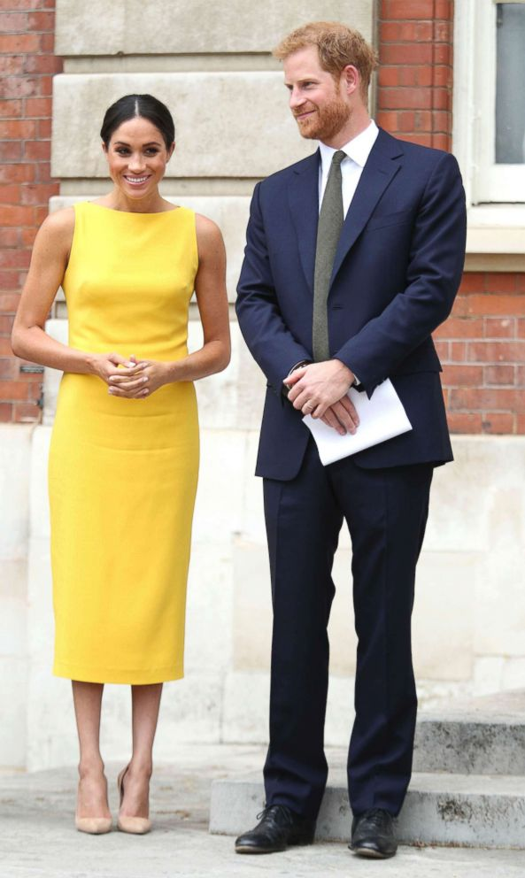PHOTO: Meghan Markle, the Duchess of Sussex and Britains Prince Harry stand as they attend the Your Commonwealth Youth Challenge reception where they will meet youngsters from across the Commonwealth, at Marlborough House in London, July 5, 2018.