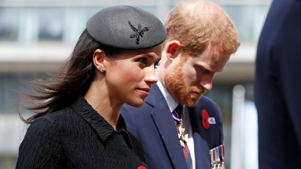 Britain's Prince Harry and his fiancee Meghan Markle arrive to attend a service of commemoration and thanksgiving to mark Anzac Day in Westminster Abbey in London on April 25, 2018.