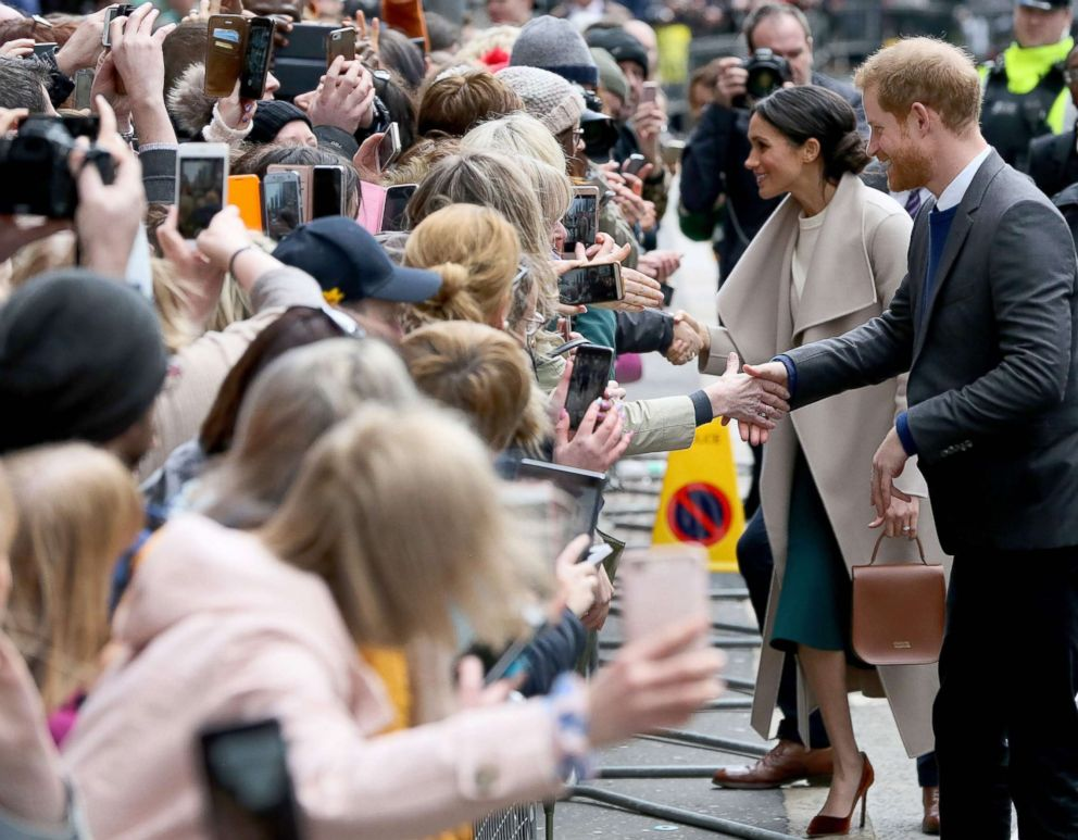 PHOTO: Britains Prince Harry and Meghan Markle, greet well-wishers after a visit at the historic building, The Crown Liquor Saloon in Belfast, March 23, 2018, where they will learn of the pubs heritage from members of the National Trust.
