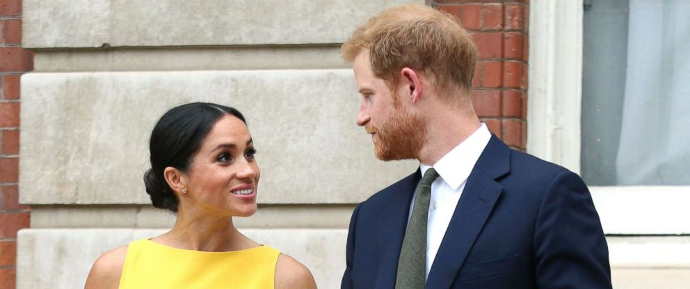 PHOTO: Meghan Markle, the Duchess of Sussex and Britains Prince Harry, the Duke of Sussex stand as they attend a reception where they will meet youngsters from across the Commonwealth, at Marlborough House in London, July 5, 2018.
