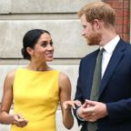 Meghan Markle, the Duchess of Sussex and Britain's Prince Harry, the Duke of Sussex stand as they attend the 'Your Commonwealth' Youth Challenge reception where they will meet youngsters from across the Commonwealth, at Marlborough House in London, July 5, 2018.