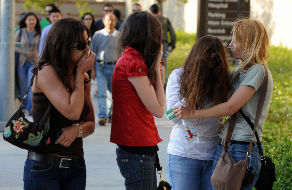 PHOTO: Fans weep and console each other outside outside the UCLA Medical Center following the death of music legend Michael Jackson on June 25, 2009 in Los Angeles.