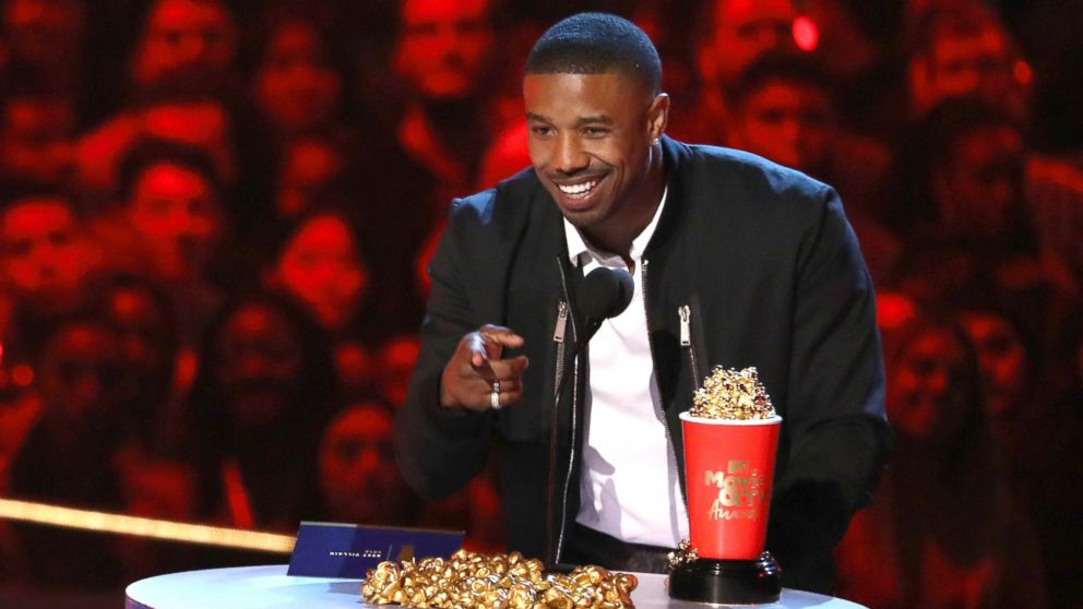 """In this Saturday, June 16, 2018, photo, Michael B. Jordan accepts the best villain award for """"Black Panther"""" at the MTV Movie and TV Awards at the Barker Hangar in Santa Monica, Calif."""