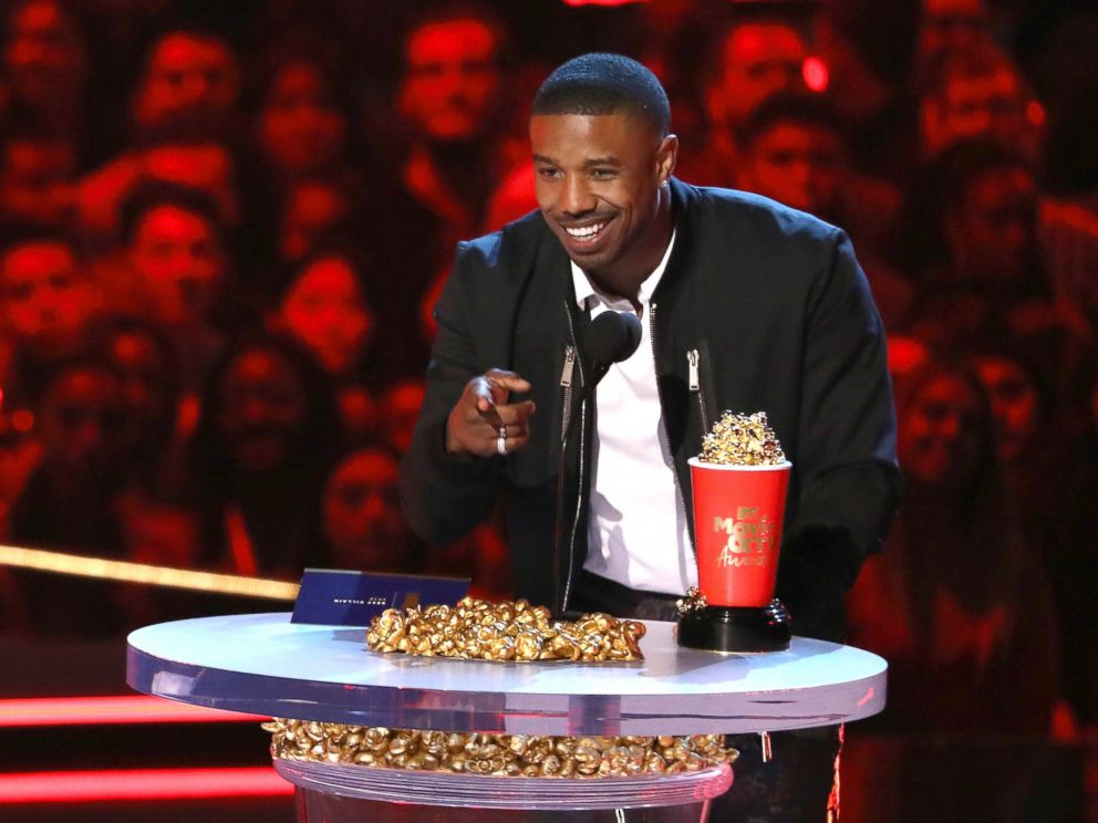 In this Saturday, June 16, 2018, photo, Michael B. Jordan accepts the best villain award for Black Panther at the MTV Movie and TV Awards at the Barker Hangar in Santa Monica, Calif.