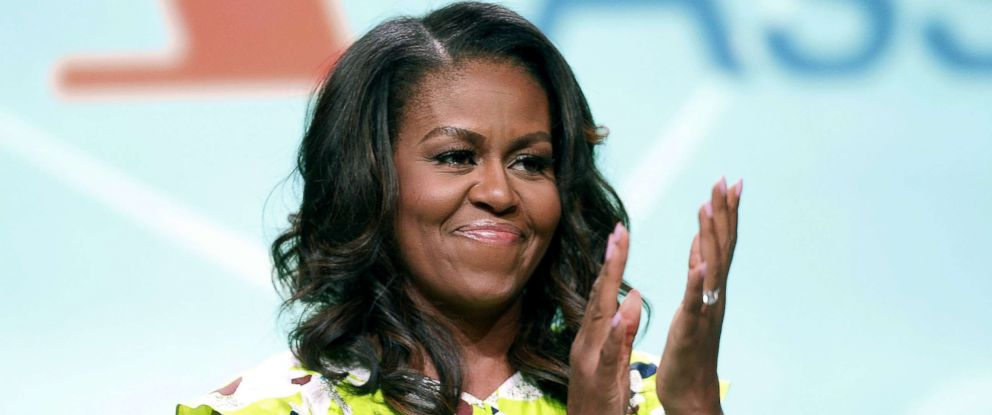 """PHOTO: Former first lady Michelle Obama waves after discussing her forthcoming memoir titled, """"Becoming,"""" during the 2018 American Library Association annual conference, June 22, 2018, in New Orleans."""
