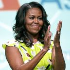 """Former first lady Michelle Obama waves after discussing her forthcoming memoir titled, """"Becoming,"""" during the 2018 American Library Association annual conference, June 22, 2018, in New Orleans."""