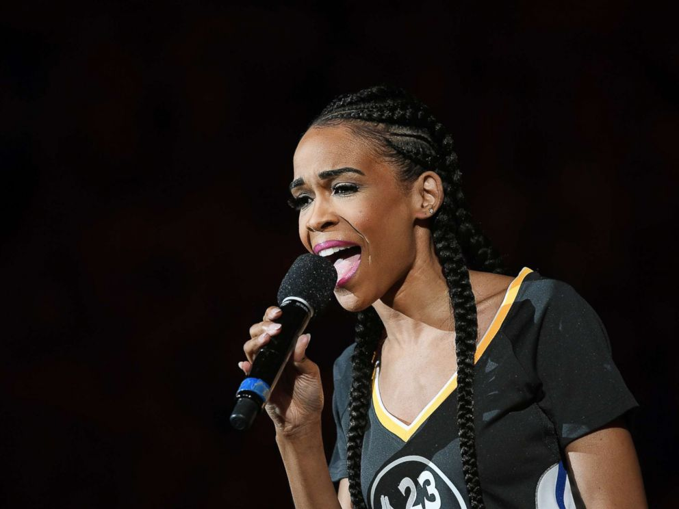 PHOTO: American singer, songwriter and actor Michelle Williams sings the National Anthem prior to Game One of the Western Conference Quarterfinals 2016 NBA Playoff game, April 16, 2016, in Oakland, Calif.