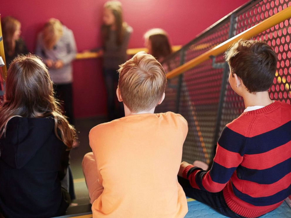 PHOTO: Middle-school aged students sit on a school stairwell in an undated stock photo.