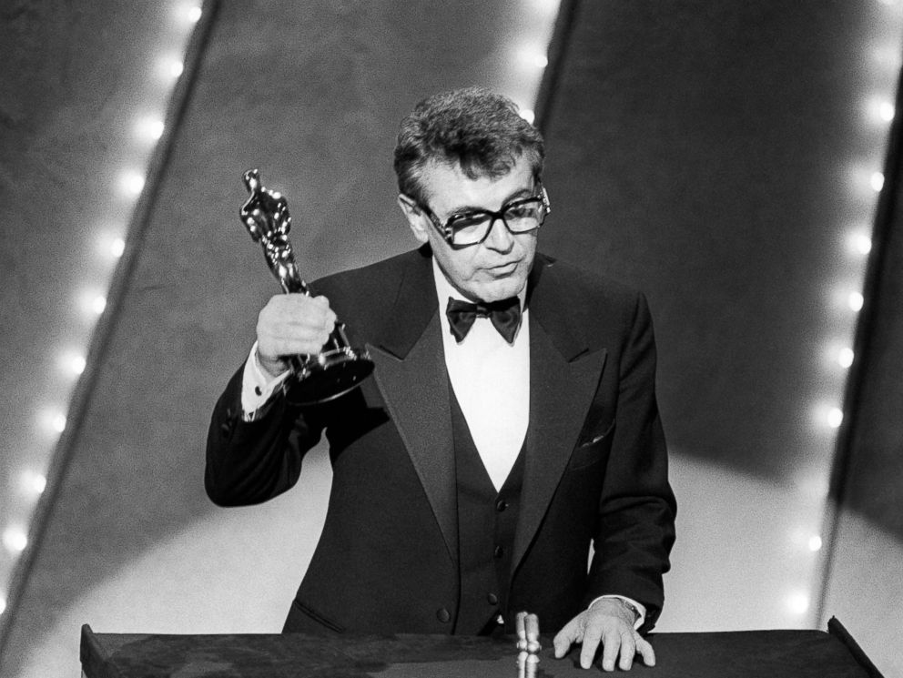 PHOTO: In this file photo taken on March 25, 1985 Czech-born U.S. film director Milos Forman holds up his Oscar trophy for his film Amadeus at the 57th Annual Academy Awards in Hollywood, Calif.