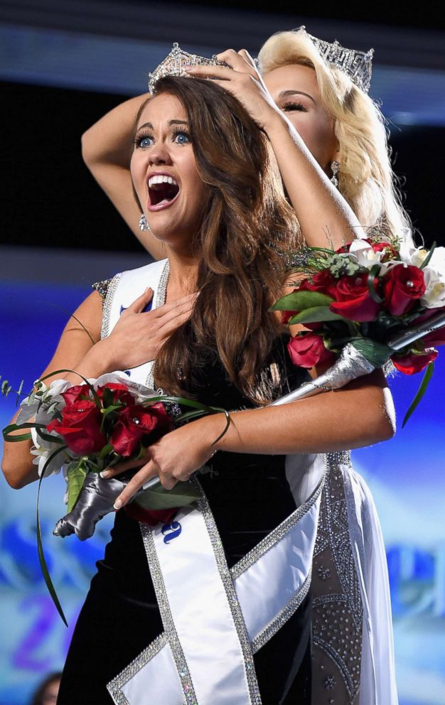 Miss North Dakota 2017 Cara Mund is crowned as Miss America 2018 by Miss America 2017 Savvy Shields during the 2018 Miss America Competition Show at Boardwalk Hall Arena, Sept. 10, 2017, in Atlantic City, N.J.
