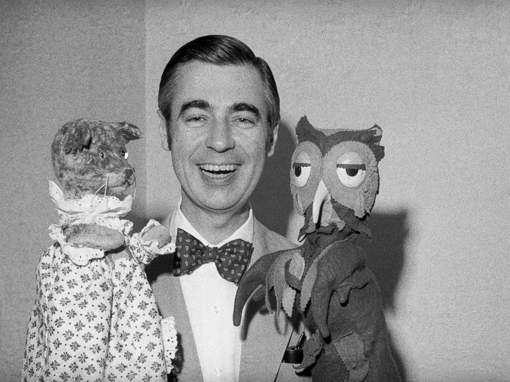 PHOTO: Fred Rogers of Mister Rogers Neighborhood holds Henrietta Pussycat and X the Owl.