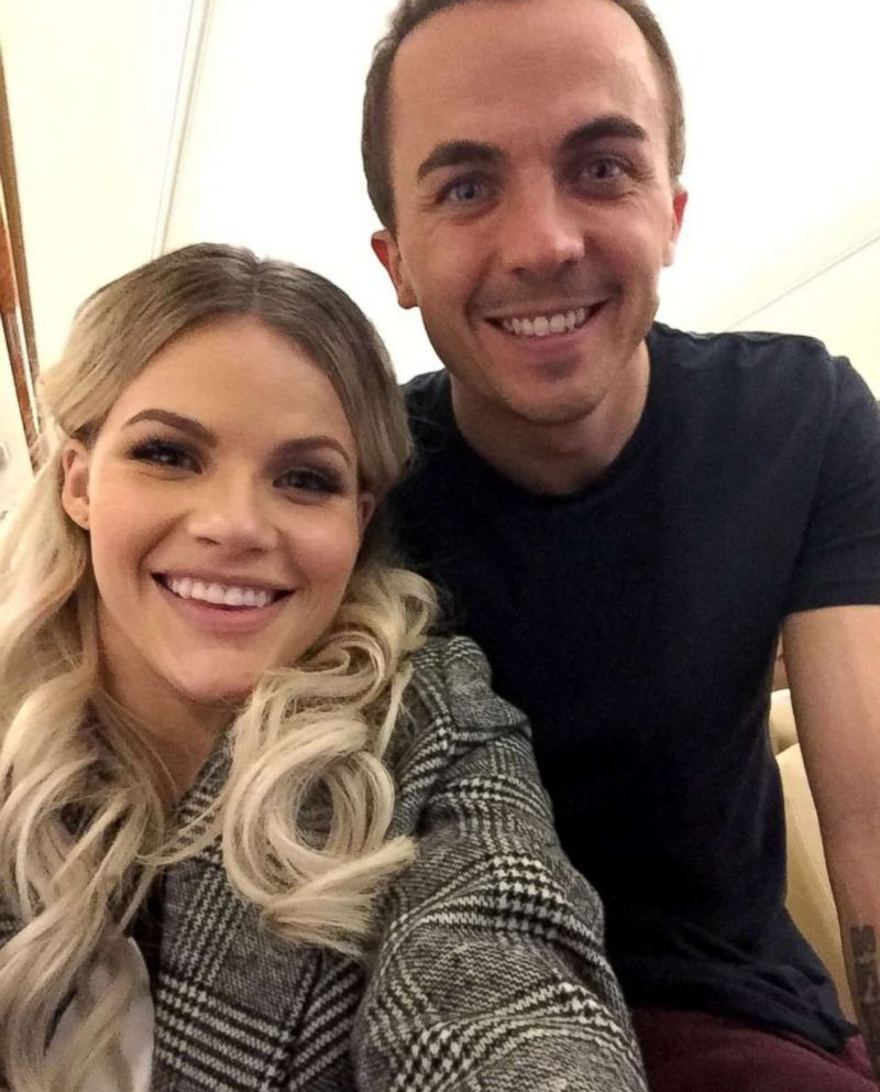 PHOTO: Frankie Muniz and his partner Witney Carson aboard the flight to New York.