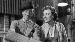 PHOTO: Nanette Fabray sits next to Fred Astaire reading music in a scene from the film The Band Wagon, 1953.