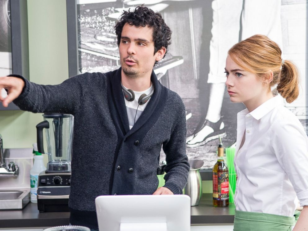 Damien Chazelle directs actress Emma Stone on the set of La La Land.