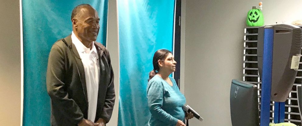 PHOTO: O.J. Simpson smiling for a drivers license photo at the DMV office in Las Vegas on October 18.