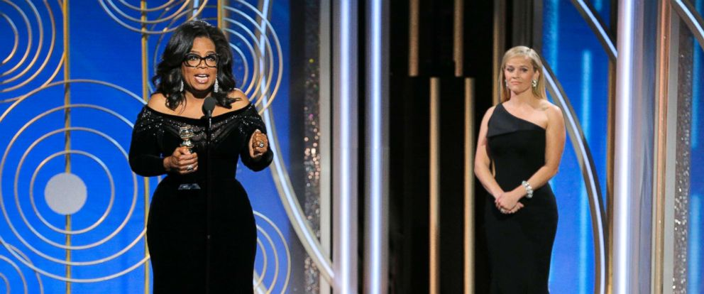 PHOTO: Oprah Winfrey accepts the Cecil B. DeMille Award as presenter Reese Witherspoon looks on, at the 75th Annual Golden Globe Awards in Beverly Hills, Calif., Jan. 7, 2018.
