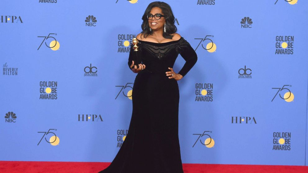 Oprah Winfrey poses in the press room with the Cecil B. DeMille Award at the 75th annual Golden Globe Awards at the Beverly Hilton Hotel, Jan. 7, 2018, in Beverly Hills, Calif.