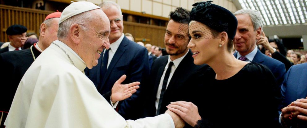 PHOTO: Pope Francis shake hands with Orlando Bloom and Katy Perry as he attends an audience by Pope Francis for the participants in the United to Cure international conference on the cure for cancer in the Paul VI hall, at the Vatican, April 28,2018.