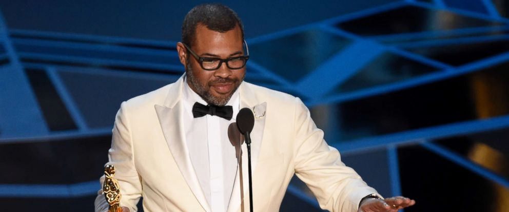 "PHOTO: Jordan Peele accepts the award for best original screenplay for ""Get Out"" at the Oscars at the Dolby Theatre in Los Angeles, March 4, 2018."