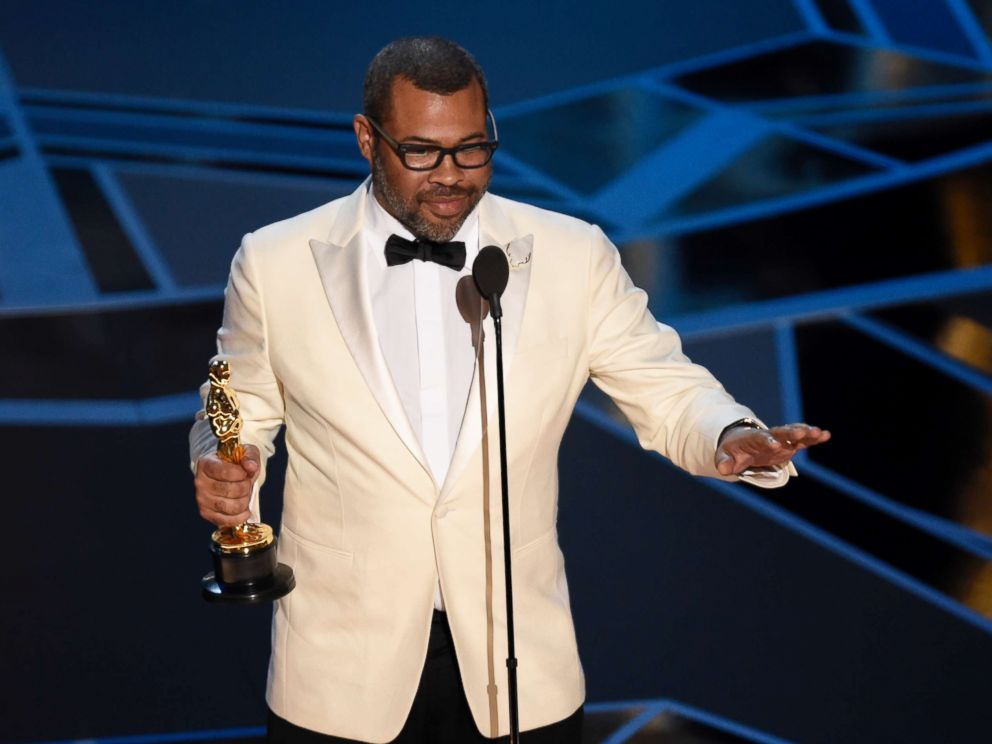 PHOTO: Jordan Peele accepts the award for best original screenplay for Get Out at the Oscars at the Dolby Theatre in Los Angeles, March 4, 2018.