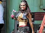 PHOTO: Danica McKellar wears a revealing outfit for Avril Lavignes music video Rock N Roll in Los Angeles on July 25, 2013.