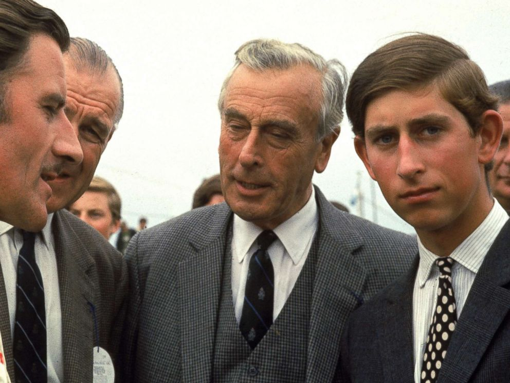 PHOTO: British race car driver Graham Hill talks with Lord Louis Mountbatten and Prince Charles, Prince of Wales, Jan. 1970.