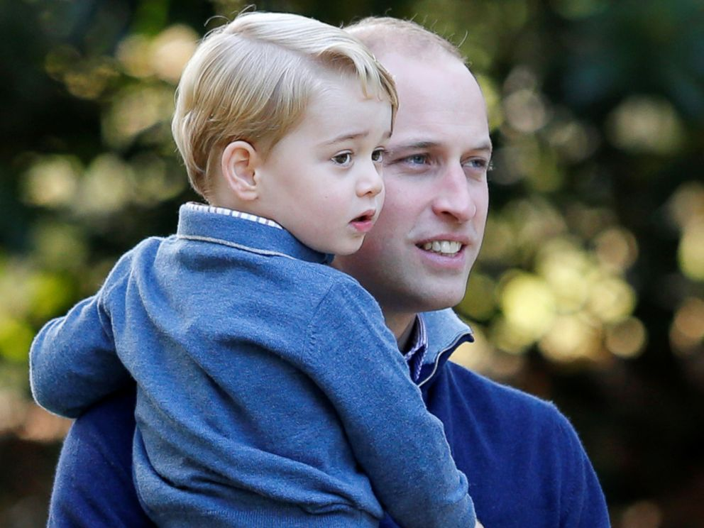 PHOTO: Britains Prince William holds Prince George during a childrens party at Government House in Victoria, British Columbia, Canada, Sept. 29, 2016.