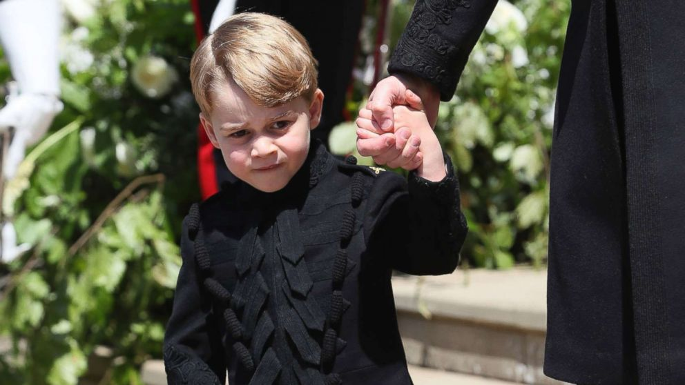 Britain's Prince George leaves after the wedding of Prince Harry and Meghan Markle at St. George's Chapel in Windsor Castle in Windsor, May 19, 2018.
