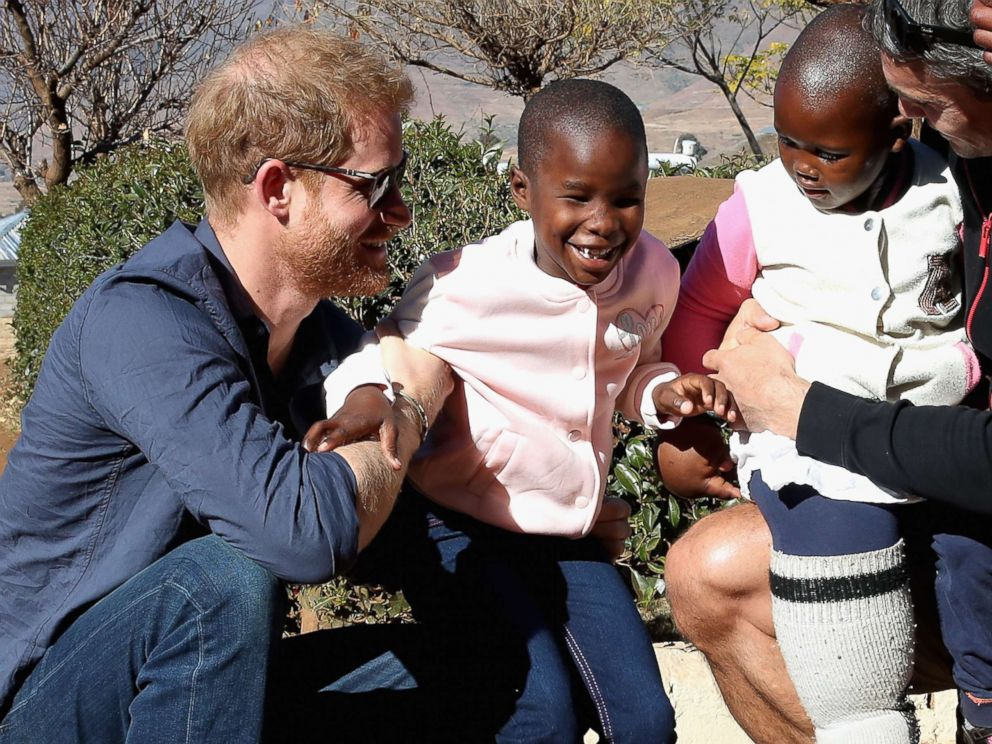 PHOTO: Prince Harry, Duke of Sussex plays with children holding balloons during the official opening of The Dining Hall at Phelisanong Childrens Home on June 23, 2018 in Leribe, Lesotho.