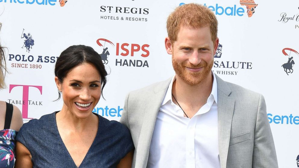 Meghan Duchess of Sussex and Prince Harry attend the Sentebale ISPS Handa Polo Cup, Berkshire Polo Club in Windsor, July 26, 2018.