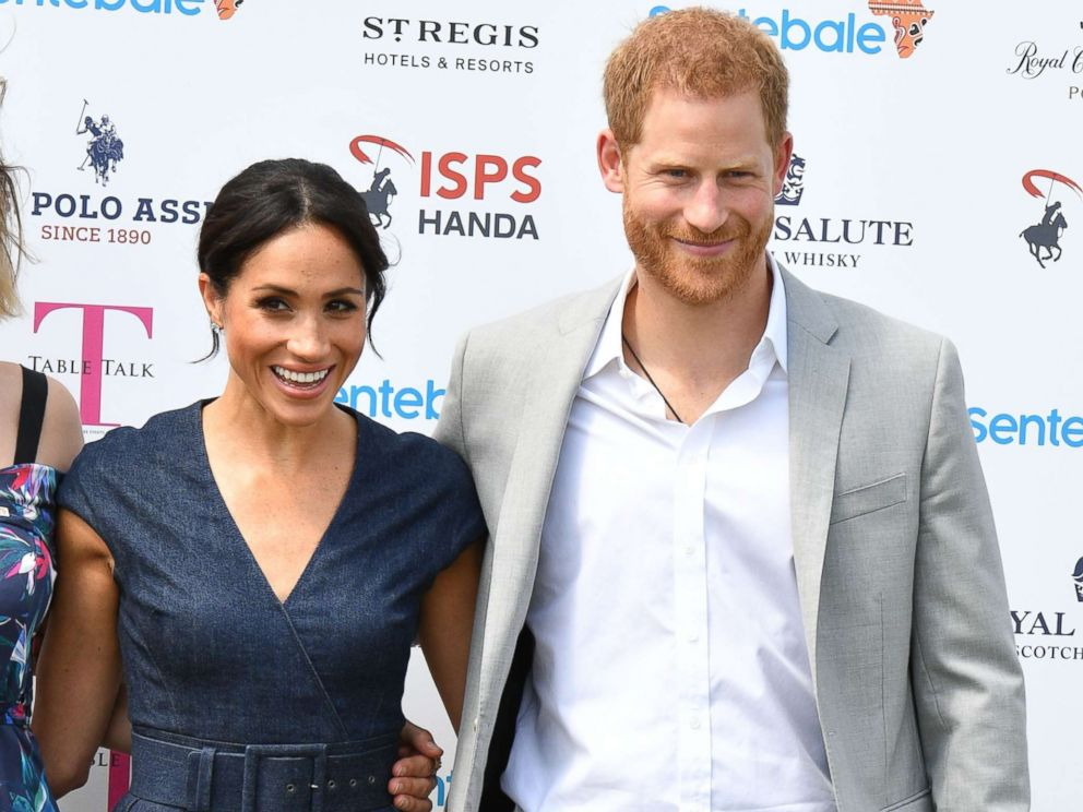 PHOTO: Meghan Duchess of Sussex and Prince Harry attend the Sentebale ISPS Handa Polo Cup, Berkshire Polo Club in Windsor, July 26, 2018.