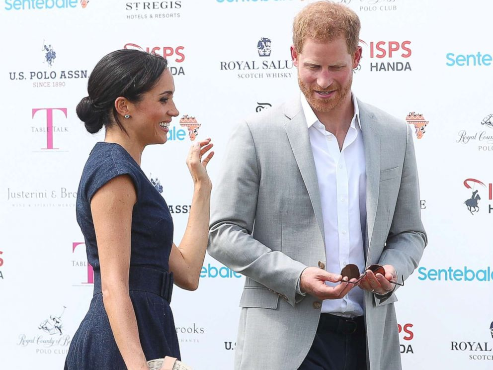PHOTO: Britains Prince Harry and Meghan the Duchess of Sussex arrive at a charity polo match in Windsor, July 26, 2018.