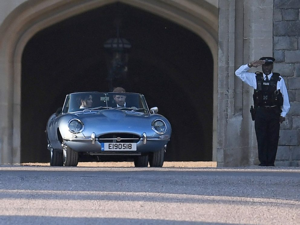PHOTO: The newly married Duke and Duchess of Sussex, Prince Harry and Meghan Markle, leave Windsor Castle in a convertible car after their wedding in Windsor, England, to attend an evening reception at Frogmore House, May 19, 2018.