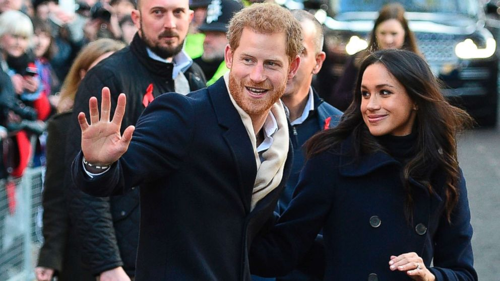 Britain's Prince Harry and his fiancee US actress Meghan Markle greet wellwishers on a walkabout as they arrive for an engagement at Nottingham Contemporary in Nottingham, England, Dec. 1, 2017 which is hosting a Terrence Higgins Trust World AIDS Day charity fair.