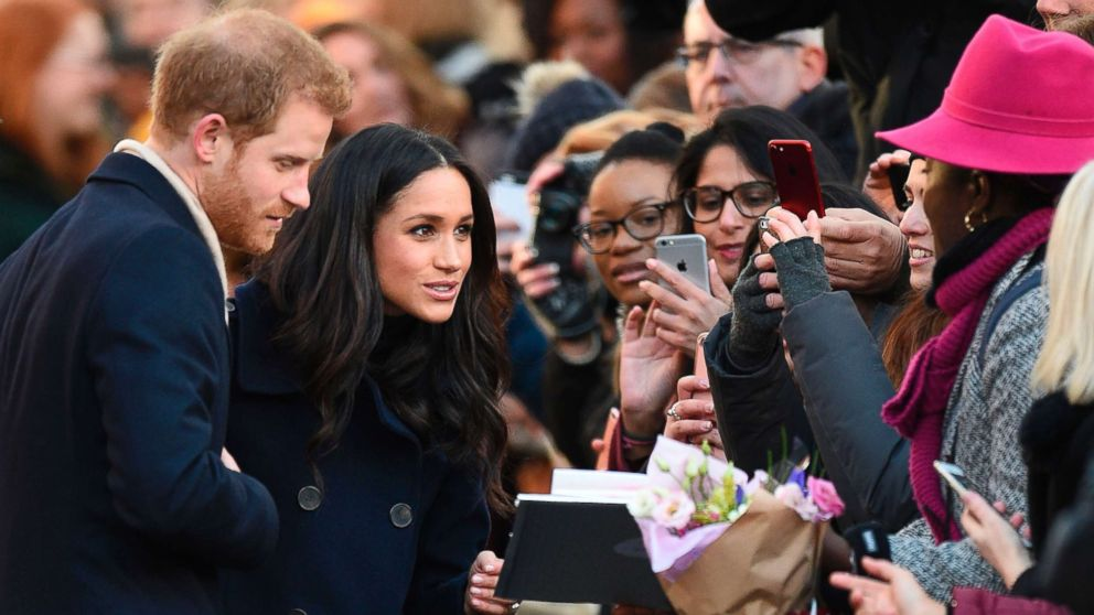 Britain's Prince Harry and his fiancee Meghan Markle greet well wishers as they arrive for the Terrence Higgins Trust World AIDS Day charity fair in Nottingham, England, Dec. 1, 2017.