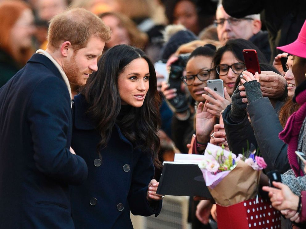 PHOTO: Britains Prince Harry and his fiancee Meghan Markle greet well wishers as they arrive for the Terrence Higgins Trust World AIDS Day charity fair in Nottingham, England, Dec. 1, 2017.