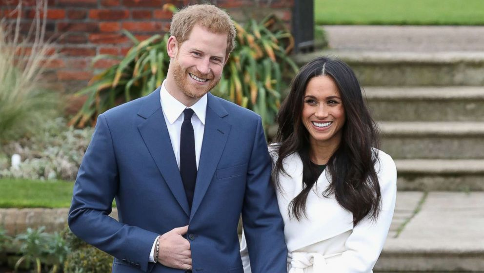 Prince Harry and Meghan Markle pose for photographers during the announcement of their engagement at the Sunken Gardens at Kensington Palace on Nov. 27, 2017 in London.