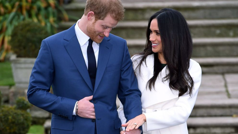 Britain's Prince Harry and Meghan Markle pose for the media in the grounds of Kensington Palace in London, Nov. 27, 2017. It was announced Monday that Prince Harry, fifth in line for the British throne, will marry American actress Meghan Markle in the spring, confirming months of rumors.