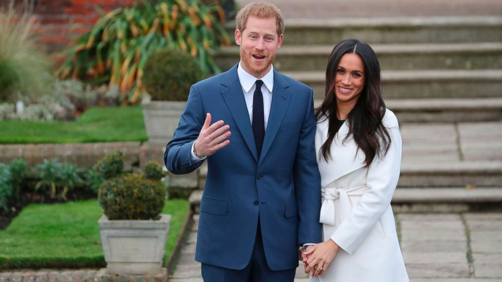 Britain's Prince Harry and his fiance U.S. actress Meghan Markle pose for a photograph in the Sunken Garden at Kensington Palace in west London, Nov. 27, 2017, following the announcement of their engagement.