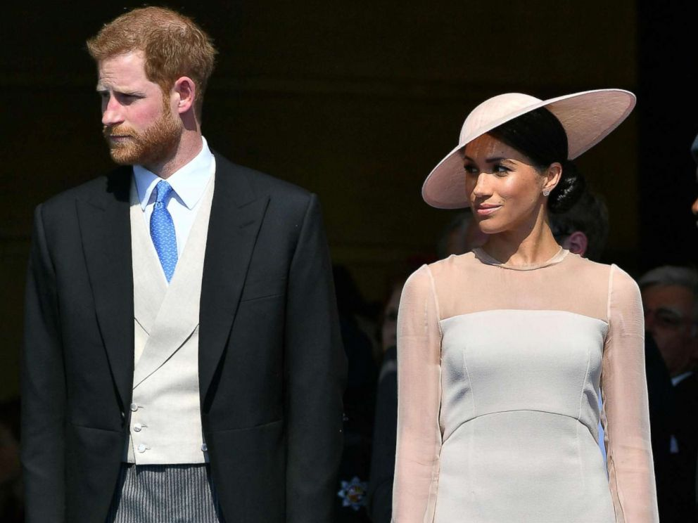 Duke of Sussex and Britains Meghan Duchess of Sussex attend the Prince of Waless 70th Birthday Garden Party at Buckingham Palace in London